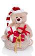 Teddy als Weihnachtsmann isoliert mit Geschenken zum Fest