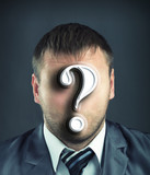 Businessman with question mark