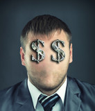 Businessman with dollar symbols