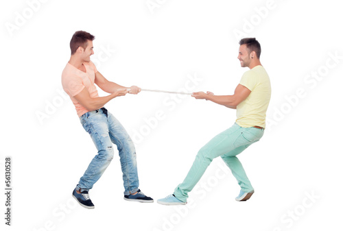 Two boys pulling a rope