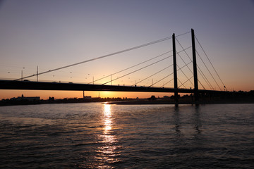 Bridge over the Rhine river at sunset. Dusseldorf, Germany