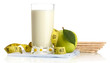 Glass of kefir, green apple, crispbreads and measuring tape