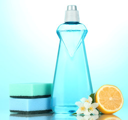 Dishwashing liquid with sponges and lemon with flowers