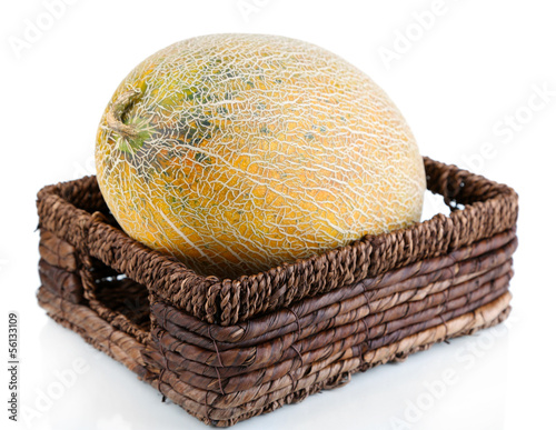 Ripe melon in basket isolated on white