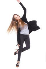 Full length The young long-haired girl posing in studio