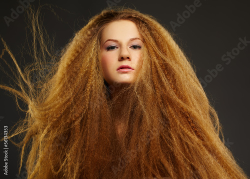 long-haired curly redhead woman