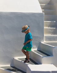 Little boy walking in Santorini