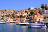 Colorful harbor with boats at Symi, Greece