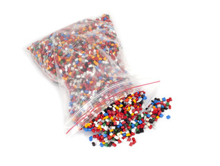 plastic polymer granules packet on white background