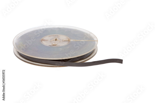 Vintage reel of audio tape on white background