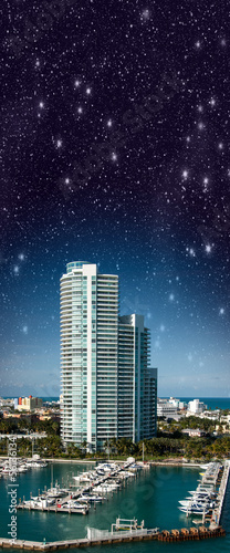 Night over Miami. Starry sky above city buildings - Florida - US