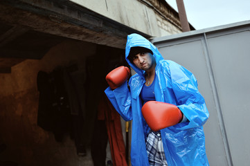 guy in the blue coat with red boxing gloves