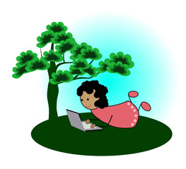 Girl with laptop under a tree