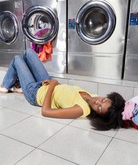 Woman Sleeping On Floor At Laundry