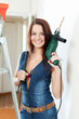 Sexy girl in dungarees with drill