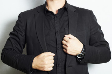 man in a business suit and black shirt.fashion.without face