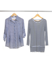 Two female clothing hanging on hangers