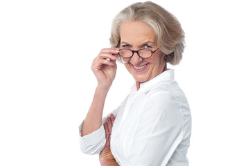 Attractive aged woman looking at you