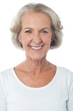 Casual aged woman posing for camera
