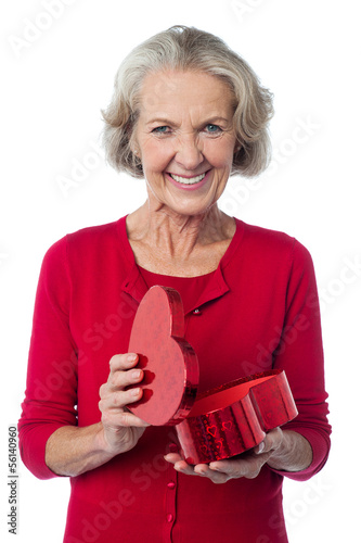 Senior woman with heart shaped gift box