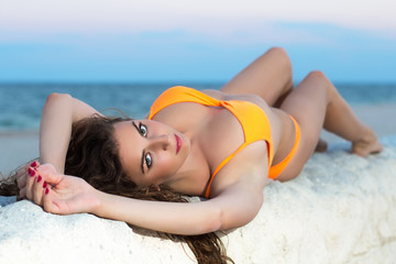 Brunette in orange swimsuit