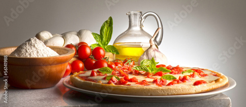 Pizza on the table whit ingredients
