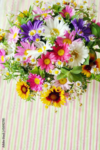 Bouquet of simple flowers on the table