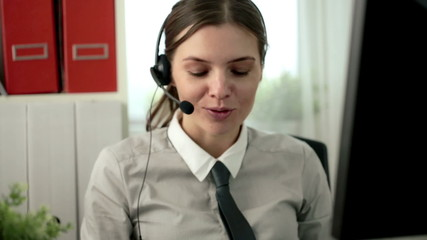 Female helpdesk consultant talking on headset
