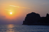 Sunset beach with big rock formation. Corfu. Greece. Ionian isla