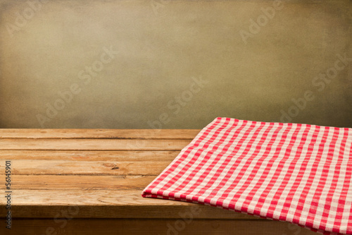 Background with empty wooden table with tablecloth