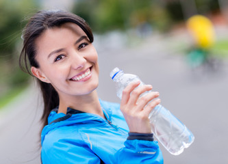 Woman hydrating after workout