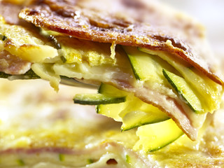extreme closeup of lasagne with zucchini