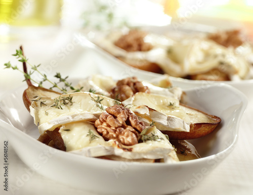 tasty baked pear with brie honey walnut and thyme