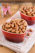Caramelized almond with cinnamon in heart-shaped red bowls
