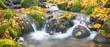 beautiful cascade waterfall in autumn forest