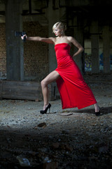 Woman in retro look aiming with gun