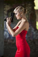 Gun woman in red dress