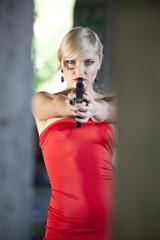 Retro Woman aiming with gun