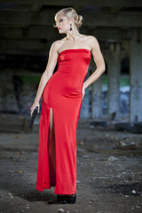 woman with gun in red dress