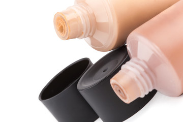 Tubes with make up liquid foundation