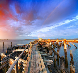 Old wooden pier at sunset.