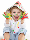 Cute little boy shows his coloured hands
