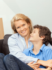 Mother and son sitting on a couch