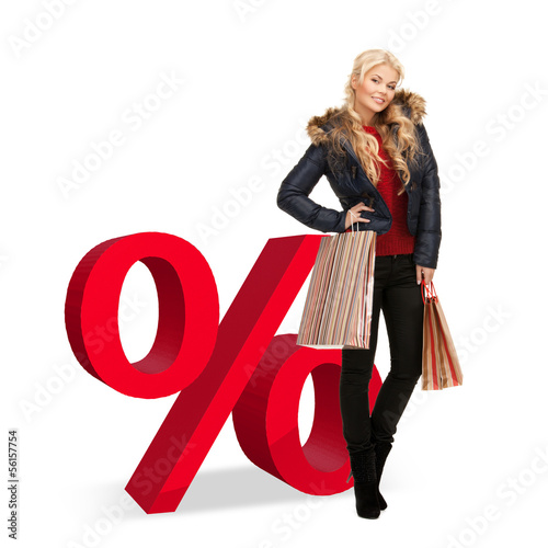 woman with shopping bags and percent sign