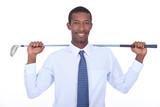 Businessman with golf club