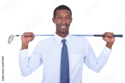 Businessman with golf club