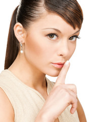 woman with finger on her lips