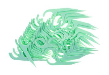 Dental floss picks mint flavor on white background