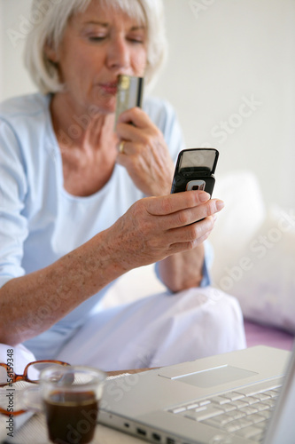Senior woman shopping on-line