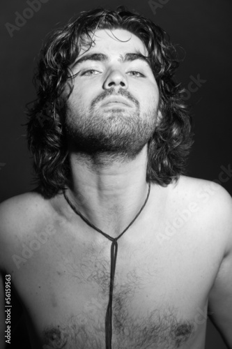 Black and white portrait of psychedelic rock style musician. Roc